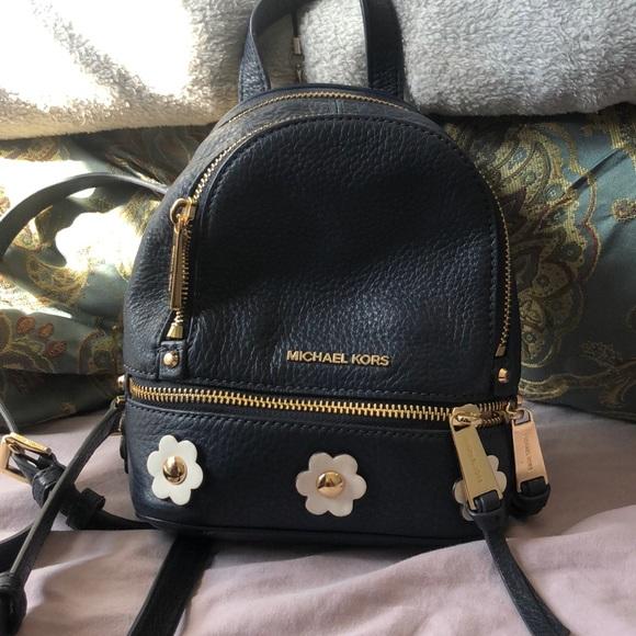 bb0704cc46d732 Michael Kors Bags | Mini Rhea Daisy Backpack | Poshmark